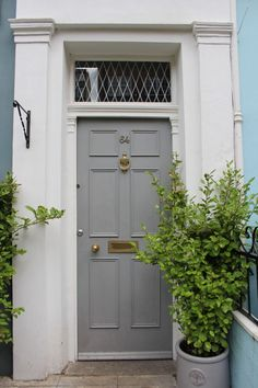 Grey painted front door in London. Come tour these gorgeous front doors in Notting Hill and Holland Park.certainly lovely indeed. Curb appeal and Paint Color Inspiration. Orange Front Doors, Black Front Doors, Brown Doors, Grey Doors, Pink Paint Colors, Front Door Paint Colors, Painted Front Doors, Boys Bedroom Colors, Front Door Makeover