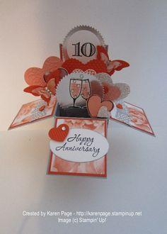 10th anniversary Card In A Box. Stampin' Up! products used: Stamps: Memorable Moments, Happy Hour, Hearts A Flutter, and Banner Blast Paper: Watercolor Wonder DSP; Smoky Slate, Tangerine Tango, Crisp Cantalope, and Whisper White CS; Silver Glitter paper, Silver Foil Sheet