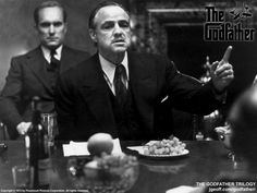 The actual Godfather, played wonderfully by Marlon Brando. Robert Duvall, plays Tom, behind Brando.