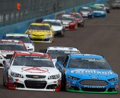 Dave Blaney and Aric Almirola trading paint at the 2013 Subway Fresh Fit 500 at Phoenix.