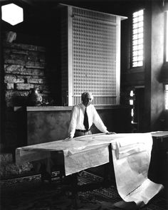 Pedro E. Guerrero, Frank Lloyd Wright stands at the drafting table in his studio at Taliesin, Wisconsin (1947)