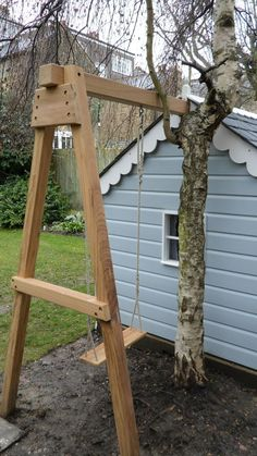 Clever use of space - swing tucked next to shed/playhouse. This is EXATLY what I want for the playhouse!