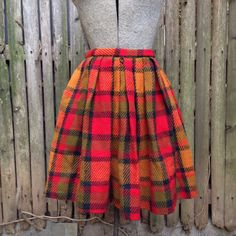 Vintage 1960's Red and Orange Plaid Wool Mini Skirt, Pleated. A fun skirt for fall through spring. It has loops for your fav belt. Wear it with tights, mary janes, or go bold with extra high heels.