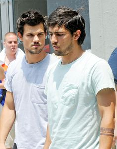 """Taylor Lautner with his stunt double on the set of """"Tracers"""" on June 24, 2013 in New York City."""