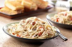 Chicken Tetrazzini Ingredients  1 can (10 3/4 ounces) Campbell's® Condensed Cream of Mushroom Soup 3/4 cup water 1/2 cup grated Parmesan cheese 2 tablespoons chopped fresh parsley or 2 teaspoons dried parsley flakes 1/4 cup chopped red pepper or drained jarred pimiento (optional) 1/2 of a 1-pound package spaghetti, cooked and drained 1 can (12.5 ounces) Swanson® Premium White Chunk Chicken Breast in Water, drained
