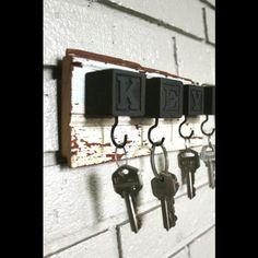 Repurpose: wood plank, kids wooden letter blocks painted, hooks = key hanger