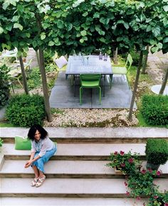 The founder of Designer Guild, Tricia Guild's garden with its square of pleached lime trees was created by designer Arne Maynard.