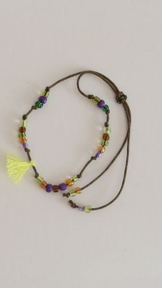 anklet with yellow tassel and coloured beads