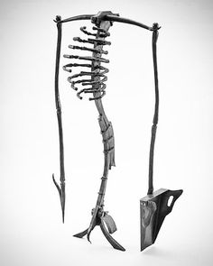 """Throw back piece. """"Even hellfire needs tending"""" fire tool set I made for a very good friend. #handforged #blacksmith #blacksmithing #forge #metalart #metalsculpture #joinery #skeleton #bones #fireplace by phyreforge"""