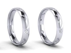 18ct White gold wedding rings, with diamond detail.