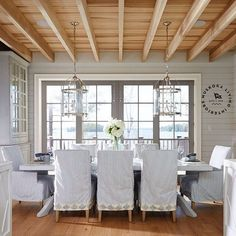 dining room coastal with slipcovered chairs french doors keep the focus view this lake front