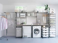 Organized Laundry Room home clothes decorate storage shelves laundry organization washer