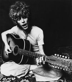 David Bowie plays an acoustic Espana 12-string guitar at the time of the release of Space Oddity in 1969 in London