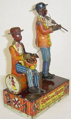 tin musical wind up toy