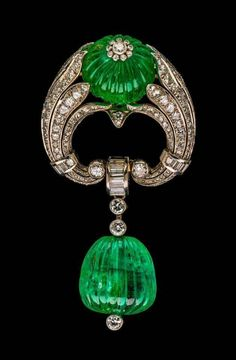 Art Deco platinum, carved emerald and diamond brooch by Josef Siess Söhne. Austrian, circa 1937. Platinum, white gold, emeralds, and diamonds Alphonse de Rothschild gave this brooch to his wife Clarice for their wedding anniversary.