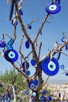 evil eye, or nazar, is an amulet that protects against bad luck, commonly found throughout the Middle and Near East. Tying them to a tree ensures good luck and protection. Evil Eye Art, Turkish Eye, Marmaris, Cool Eyes, Deviantart, Pictures, Inspiration, Tattoos, Istanbul