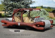 Cars - Yes, it is the Flintmobile and, yes, George Barris designed it. Serial number 10,000,000 BC (no, really). Ironically it's powered by electricity, not footwork.