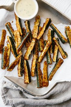 (Zucchini fries work great in an air fryer!) These baked zucchini fries are ultra cheesy and flavorful with freshly grated Parmesan cheese. They're also gluten-free, low-carb, paleo and keto-friendly for a delicious, healthy snack recipe. Healthy Recipes, Low Carb Recipes, Vegetarian Recipes, Snack Recipes, Cooking Recipes, Free Recipes, Yogurt Recipes, Keto Foods, Keto Snacks