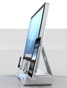 Wow. I can only wish.  The Docking and Storage Base for iMac, iPod, iPhone & iPad by Yaser Alhamyari » Yanko Design
