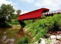 Probably the most famous of all Madison County's bridges, Roseman Covered Bridge featured prominently in both the book and film. Built by Benton Jones in 1883, it was renovated in 1992.  Near Winterset, Iowa where the Bridges of Madison County was filmed.