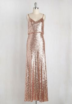 All it takes is donning this sequined gown by Jenny Yoo to put your red carpet dreams well within reach! A radiant piece for the most sophisticated affairs, this elegant dress astonishes with a dramatic draped back, a blend of copper and rose gold tones, and the luxe aesthetic you've always envisioned.