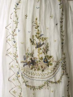 Tambour embroidery detail of petticoat, 1790, England, of Indian muslin. Museum of London