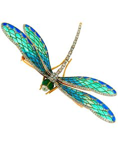 An Art Nouveau dragonfly brooch, France, 1910s. Designed as a dragonfly with articulated wings, the brooch is composed of yellow gold, plique-à-jour enamel and cushion cut diamonds, mounted in silver, with maker's mark.