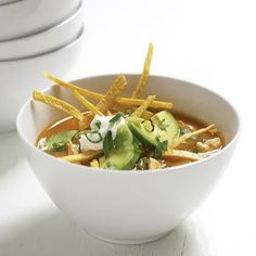 Tortilla Soup - Even with fried tortilla strips, this Mexican soup boasts fewer than 150 calories per serving. Serve with light sour cream and cheese for low-cal toppings Mexican Soup Recipes, Healthy Soup Recipes, Wine Recipes, Mexican Dinners, Cooking Recipes, Fast Recipes, Food For Thought, Guisado, Chicken Tortilla Soup