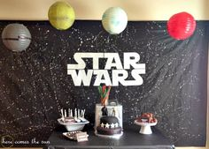 For the dessert table backdrop, I used a black plastic tablecloth and splattered it with white paint to look like the galaxy. I used my Silhouette to cut out the Star Wars logo on white vinyl. For the planets and Death Star hanging above the table, I used Decoration Star Wars, Star Wars Party Decorations, Birthday Balloon Decorations, Birthday Balloons, Birthday Parties, Diy Birthday, Birthday Cakes, Birthday Ideas, Table Decorations