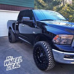 "20x10"" Fuel Off-Road Hostage Wheels with 35x12.50x20 Toyo Open Country MT Tires on a 2012 Dodge Ram 1500"