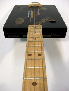 Here's a cigar box that made a sharp lookin' cigar box guitar. The 'Connoisseur Collection 3 String Cigar Box Guitar',