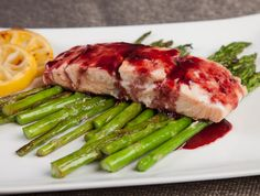 A one pot healthy dinner. A tangy & sweet blackberry glaze flavors the salmon that is served over fresh asparagus.