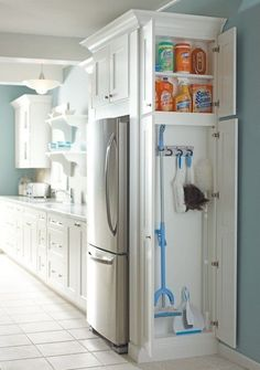 Love this side cupboard on the side of the fridge for brooms and cleaning stuff.