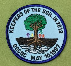 Girl Scouts Nation's Capital 100th anniversary patch. Keepers of the Soil 2012, GSCNC May 10, 1997. Not sure exactly what this is or when, but it does say 2012.