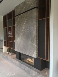 Walnut wall, Nano Tech cabinets and metal shelves where the Fior Di Bosco is a show stopper. Home Fireplace, Fireplace Remodel, Modern Fireplace, Living Room With Fireplace, Fireplace Design, Living Room Decor, Fireplaces, Office Interior Design, Interior Design Living Room