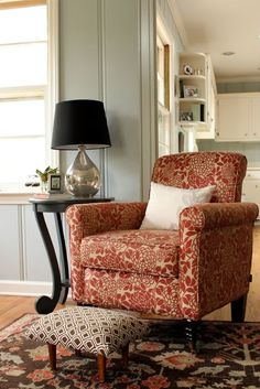 Family Room: Orange anthropologie style chair from Overstock.com, tobacco blue table and mercury glass lamp from World Market, woodlawn sterling blue wall color, orange and blue