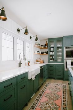Kitchen Cabinet Inspiration A round-up of the best green kitchen cabinet paint colors for the hottest bold kitchen color trend.A round-up of the best green kitchen cabinet paint colors for the hottest bold kitchen color trend. Green Kitchen Cabinets, Painting Kitchen Cabinets, White Cabinets, Colored Cabinets, Green Kitchen Paint, White Counters, Kitchen Walls, Kitchen Sink, Kitchen Corner