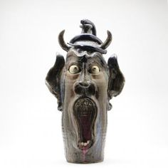 """large face jug with coiled snake, polychrome glazed earthenware, typical wide-open screaming mouth exposing clay teeth (one broken), inscribed on the rear """"William A Flowers NC mtns 1997""""."""
