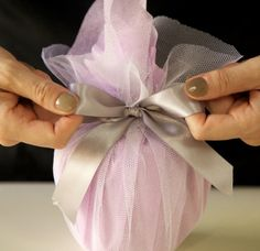Gift Wrapping Inspiration * Wrapping with Netting and tying off with a satin ribbon.