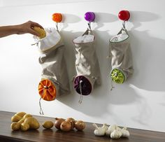 Drawstring vegetable bags to keep potatoes, onions, and garlic heads away from light (delaying the sprouting process). | 39 Awesome Things You Never Knew You Needed For Your Kitchen