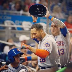 James Loney celebrates hitting a home run as Asdrubal Cabrera removes his helmet.