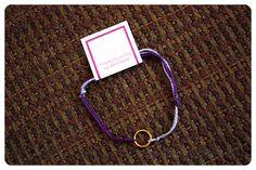 September 2014 Helene Jewelry Box: Bonus: Friendship Bracelet. As an unexpectied bonus this month, the Helene Jewelry Box included a special appreciation gift for customers. This accessory puts an adult spin on the classic friendship bracelet. The bracelet features two-tone purple string tied around a delicate gold-colored ring. Price: USD $25.00/month -- #beauty #helenejewelry #jewelry #accessories #fashion #bracelet #subscriptionbox