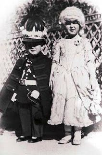 HRH Princess Antoinette of Monaco (1920-2011) with her brother Rainier (left) dressing in costumes