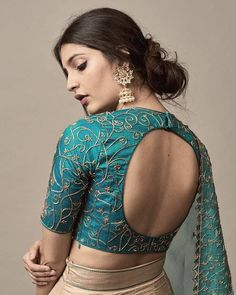 While selecting your desired bridal lehenga, don't forget to pick a stylish blouse design that will compliment your whole look. Indian Blouse Designs, Brocade Blouse Designs, Blouse Designs High Neck, Choli Blouse Design, Saree Jacket Designs, Fancy Blouse Designs, Designer Blouse Patterns, Bridal Blouse Designs, Choli Designs