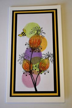 hand crafted card from Eileen's Crafty Zone ... tall and thing format ... background = column of sponged circles ... line are fantasy flowers stampen and colored on tome ... great card ... triple mat frames  and finishes it all ...