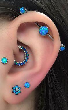 Cute Multiple Blue Opal Ear Piercing Ideas For Women # Blue . - Nice Multiple Blue Opal Ear Piercing Ideas For Women # Blue # - Female Piercings, Cool Ear Piercings, Multiple Ear Piercings, Tongue Piercings, Unique Body Piercings, Innenohr Piercing, Cartilage Piercings, Peircings, Ear Piercings