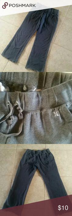 Gray sweatpants Hurley gray sweatpants, front pockets, elasticized waistband and drawstring, distressed hem Hurley Pants Track Pants & Joggers