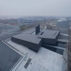 A tilted and fractured black box that emerges from a public square in the Chinese city of Harbin contains display areas dedicated to telling the story of war crimes committed during the Japanese occupation of Manchuria.