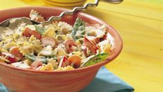 Farmers market basil and produce mixed with bow-ties and Parmesan make the perfect pasta salad to serve at your next backyard get-together.