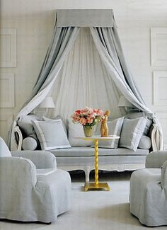 Soft grey daybed.  I like the curtains.  I would close them around me & pretend I'm in a fort.  :)